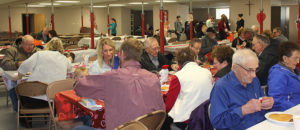 Church members enjoy a pancake breakfast in their newly renovated church basement.