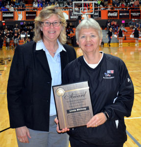 "RETIRED SUPERINTENDENT of Sanborn Central High School Linda Whitney received a Distinguished Service Award from a representative of the South Dakota High School Activities Association Friday evening at the State ""B"" Tournament. PHOTO COURTESY SOUTH DAKOTA PUBLIC BROADCASTING"