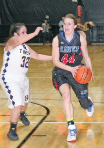 MYAH SELLAND drives on a defender during this year's Class B tournament.