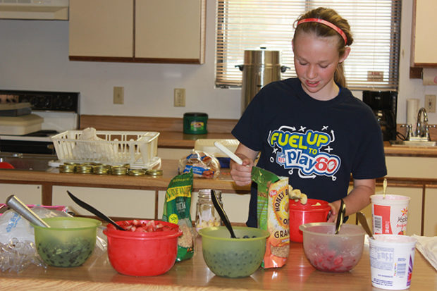 Fuel Up to Play 60 SD Ambassador Bailey Feistner teaches club members how to make an easy healthy snack.