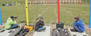 Shooters compete on the 22 CMP Rifle line at the State Shoot – Nathan Linke, Megan Linke and Aaron Linke.