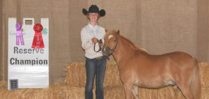 Bailey Feistner proudly shows off her pony and second place ribbon for Jr. Pony Western Showmanship at the SD State 4-H Horse Show.