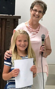 PICTURED ARE Poppy Poster contest winner Cameron Edwards and American Legion Auxiliary President Sandi Ruml.